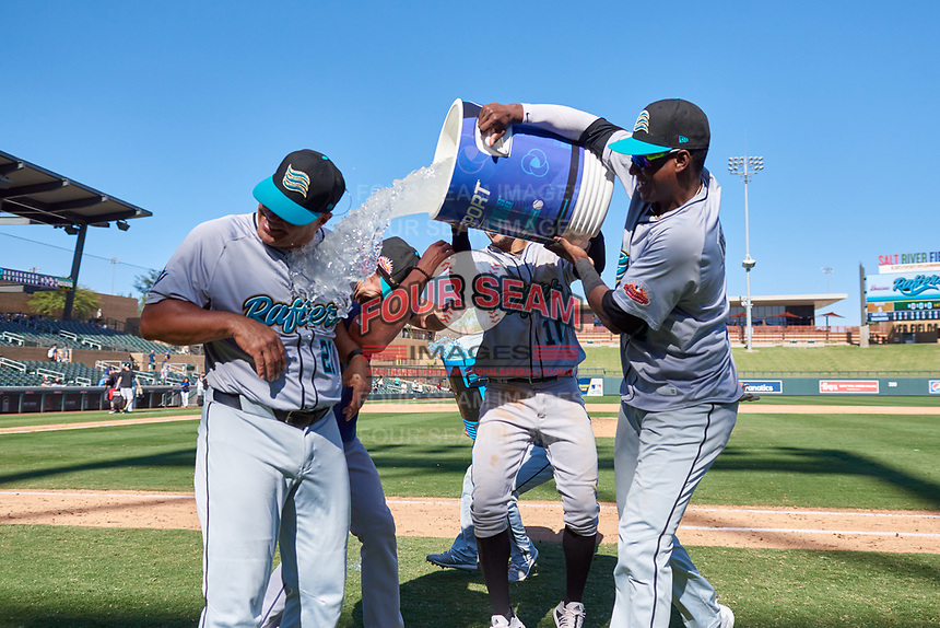Salt River Rafters teammates Victor Victor Mesa (10) and Geraldo Perdomo (7) splash water on manager Keith Johnson (21) after winning the Arizona Fall League Championship Game against the Surprise Saguaros on October 26, 2019 at Salt River Fields at Talking Stick in Scottsdale, Arizona. The Rafters defeated the Saguaros 5-1. (Zachary Lucy/Four Seam Images)