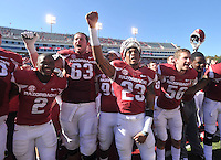 NWA Media/Michael Woods --10/25/2014-- w @NWAMICHAELW...University of Arkansas players D.J. Dean (2) Dan Skipper (63) Tevin Mitchel (23) Matt Emrich (56) and the rest of the team sing the fight song with fans as they celebrate their 45-17 homecoming win over University of Alabama Birmingham after Saturday's game at Razorback Stadium in Fayetteville.