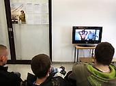 Young Polish men watch Rambo while waiting for medical, required before the army draft.<br /> This year's draft is the last one as Polish army is turning professional.<br /> Piaseczno, central Poland, March 2008<br /> (Photo by Piotr Malecki / Napo Images<br /> <br /> Mlodziez oczekuje i oglada Rambo.Komisja lekarska do badan mlodych mezczyzn pod katem ich przydatnosci do sluzby wojskowej.<br /> Poniewaz Wojsko Polskie ma byc zawodowe, tegoroczny pobor w dotychczasowej formie bedzie najprawdopodobniej poborem ostatnim.<br /> Piaseczno, Marzec 2008<br /> Piotr Malecki / Napo Images