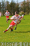 An Ghaeltacht Gearoid Sayers tackled by Lios Póil Sean Dorgan during the CFL Div. 3 match at Lispole GAA Grounds on Sunday afternoon.