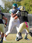 Palos Verdes, CA 10/07/16 - unidentified Mira Costa player(s) and Jason Augello (Peninsula #58) in action during the CIF Bay League game between Mira Costa and Peninsula.