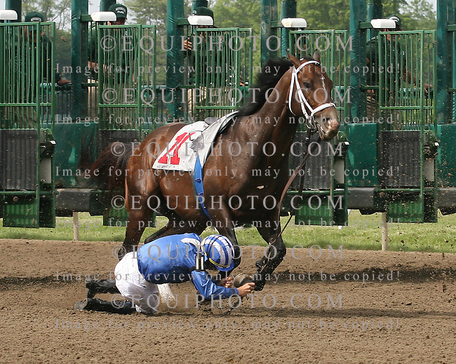 Jockey Garrett Gomez is hit in the head by his mount Jadal #11 after the horse stumbled coming out of the gate and dropped Gomez in the 7th race at Monmouth Park in Oceanport, N.J. on Saturday May 22, 2010.  Gomez was taken to the hospital for observation.  Photo By Bill Denver/EQUI-PHOTO