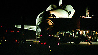 "Crew and technicians surround the orbiter after landing, Space Shuttle  Atlantis, STS 101Mission, May 2000, Kennedy Space Center, Titusville, FL.  Crew:  Commander James D. Halsell Jr., Pilot Scott J. ""Doc"" Horowitz, Mission Specialists Mary Ellen Weber, Jeffrey N. Williams, James S. Voss, Susan J. Helms and Yury Vladimirovich Usachev.  (Photo by Brian Cleary/bcpix.com)"