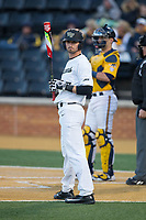Jake Mueller (6) of the Wake Forest Demon Deacons looks to his third base coach for the signs during the game against the Kent State Golden Flashes in game two of a double-header at David F. Couch Ballpark on March 4, 2017 in Winston-Salem, North Carolina.  The Demon Deacons defeated the Golden Flashes 5-0.  (Brian Westerholt/Four Seam Images)
