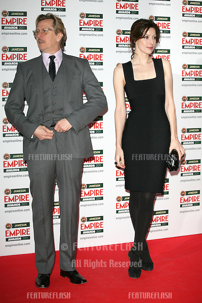 Gary Oldman and wife Alex arriving for the Jameson Empire Awards 2011, Grosvenor House Hotel, London. 27/03/2011  Picture by: Alexandra Glen / Featureflash