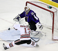 Minnesota State University-Mankato goalie Phil Cook can't stop a shot by UNO's Zahn Raubenheimer during the first period of Saturday night's game at Qwest Center Omaha. (Photo by Michelle Bishop).