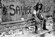 July 1972, The Bronx, New York City, New York State, USA --- A member of the New York street gang Savage Skulls. The trademark of the, primarily Puerto Rican, gang was a sleeveless denim jacket with a skull and crossbones design on the back. Based around Fox Street, in the popular South Bronx neighbourhood, the gang declared war on the drug dealers that operated in the area. Running battles were frequent with rival gangs Seven Immortals, and Savage Nomads. --- Image by © JP Laffont