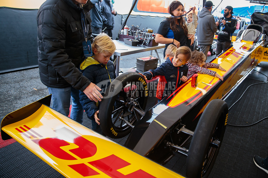 Feb 10, 2019; Pomona, CA, USA; Young NHRA fans touch the dragster of top fuel driver Richie Crampton during the Winternationals at Auto Club Raceway at Pomona. Mandatory Credit: Mark J. Rebilas-USA TODAY Sports