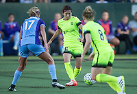 Seattle, WA - Saturday July 23, 2016: Dani Weatherholt, Nahomi Kawasumi, Kim Little during a regular season National Women's Soccer League (NWSL) match between the Seattle Reign FC and the Orlando Pride at Memorial Stadium.
