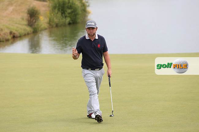 Andy Sullivan (ENG) makes par on 16 during Round Three of the 2015 Alstom Open de France, played at Le Golf National, Saint-Quentin-En-Yvelines, Paris, France. /04/07/2015/. Picture: Golffile | David Lloyd<br /> <br /> All photos usage must carry mandatory copyright credit (&copy; Golffile | David Lloyd)