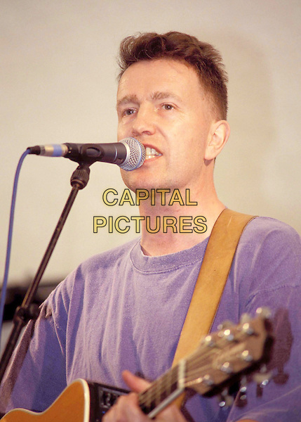 TOM ROBINSON.Ref:460.singing, live, concert, guitar, stage,headshot, portrait.www.capitalpictures.com.sales@capitalpictures.com.© Capital Pictures