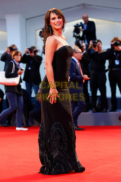 Lorena Bianchetti.The 'Lines Of Wellington' (Linhas de Wellington) Premiere during The 69th Venice Film Festival at the Palazzo del Cinema, Venice, Italy. .September 4th, 2012 .full length black strapless dress side  .CAP/IPP/GR.©Gianluca Rona/IPP/Capital Pictures.