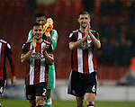 George Baldock of Sheffield Utd and Chris Basham of Sheffield Utd enjoy the win during the Championship match at the Bramall Lane Stadium, Sheffield. Picture date 27th September 2017. Picture credit should read: Simon Bellis/Sportimage