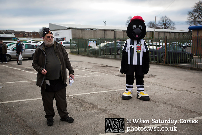 Chorley 2 Altrincham 0, 21/01/2017. Victory Park, National League North. A half-time draw seller and the home club mascot named Victor the Magpie inside the entrance to Victory Park, before Chorley played Altrincham in a Vanarama National League North fixture. Chorley were founded in 1883 and moved into their present ground in 1920. The match was won by the home team by 2-0, watched by an above-average attendance of 1127. Photo by Colin McPherson.