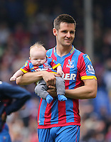Pictured: Scott Dann of Crystal Palace with his young baby thanks supporters at the end of the game<br />