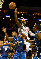 Charlotte Bobcats forward Gerald Wallace (3) works for a loose ball against Orlando Magic forward Rashard Lewis (9) during an NBA basketball game  at Time Warner Cable Arena in Charlotte, NC.