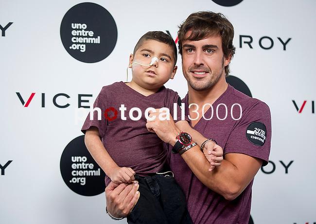 The Formula One driver Fernando Alonso has the bracelet solidarity against leukemia. Madrid. Spain. 2014/09/02. Samuel de Roman / Photocall3000