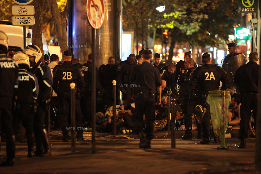 "FRANCE. PARIS. 19 September 2011: On September 19th few of ""indignants""  were arrested by the police. After more than 1200 Km walking from Spain, the ""Indignants"" reached Paris on 17th September. One of the march's most important objective is to demand a better political and economic system! Their road will continue to Brussels where they will claim a participative, real, and direct democracy."