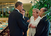 Pittsburgh, PA - September 24, 2009 -- United States President Barack Obama talks with Chancellor Angel Merkel of Germany and President Felipe Calderon Hinojosa of Mexico during a G-20 leaders working dinner at the Phipps Conservatory and Botanical Gardens in Pittsburgh, Pennsylvania, September 24, 2009. .Mandatory Credit: Pete Souza - White House via CNP