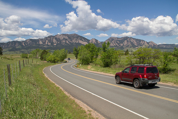Red Toyota Xterra, SUV on mountain road in Boulder, Colorado .  John leads private photo tours in Boulder and throughout Colorado. Year-round.