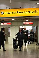 FRANCA, LONDRES, 04 DE FEVEREIRO DE 2013 - DESEMBARQUE SELECAO DO BRASIL - O auxiliar tecnico Flavio Murtosa  da Selecao Brasileira desembraca no aeroporto de Heatrow em Londres, nesta segunda-feira,(4), para Amistoso Internacional contra Inglaterra. FOTO: GUILHERME ALMEIDA / BRAZIL PHOTO PRESS