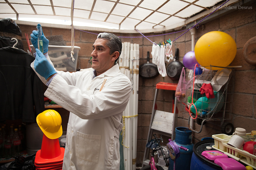 "Donovan prepares one of the 370 formulas he has devised –and memorized– in order to carry out his forensic cleaning, in the utility room behind the kitchen of his home in Texcoco, Mexico on September 21, 2015. The chemical base for some of his formulas, he says, can cost up to $6,000. Donovan Tavera, 43, is the director of ""Limpieza Forense México"", the country's first and so far the only government-accredited forensic cleaning company. Since 2000, Tavera, a self-taught forensic technician, and his family have offered services to clean up homicides, unattended death, suicides, the homes of compulsive hoarders and houses destroyed by fire or flooding. Despite rising violence that has left 70,000 people dead and 23,000 disappeared since 2006, Mexico has only one certified forensic cleaner. As a consequence, the biological hazards associated with crime scenes are going unchecked all around the country. Photo by Bénédicte Desrus"