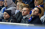 Hearts striker Ryan Stevenson watching the match at Ibrox
