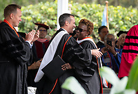 Conferring of Honorary Degree and Response - Olamide U. Ajose '87, Senior Policy Adviser for Higher Education for Governor Gavin Newsom and L.A. Mayor Eric Garcetti.<br /> Families, friends, faculty, staff and distinguished guests celebrate the class of 2019 during Occidental College's 137th Commencement ceremony on Sunday, May 19, 2019 in the Remsen Bird Hillside Theater.<br /> (Photo by Marc Campos, Occidental College Photographer)
