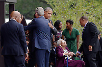United States President Barack Obama hugs former U.S. President George W. Bush as U.S. Representative John Lewis (Democrat of Georgia), left, looks on during the opening ceremony of the Smithsonian National Museum of African American History and Culture on September 24, 2016 in Washington, DC. The museum is opening thirteen years after Congress and President George W. Bush authorized its construction. <br /> Credit: Olivier Douliery / Pool via CNP / MediaPunch