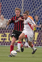 D.C. United's Ben Olsen fights for the ball with the MetroStars' Eddie Gaven. D. C. United was defeated by the NY/NJ MetroStars 3 to 2 during the MetroStars home opener at Giant's Stadium, East Rutherford, NJ, on April 17, 2004.