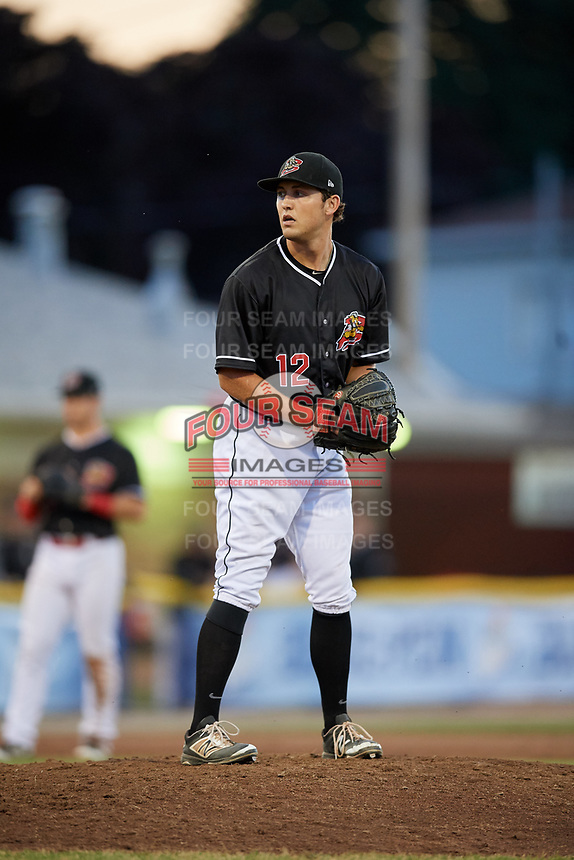 Batavia Muckdogs relief pitcher Karl Craigie (12) gets ready to deliver a pitch during a game against the State College Spikes on July 7, 2018 at Dwyer Stadium in Batavia, New York.  State College defeated Batavia 7-4.  (Mike Janes/Four Seam Images)