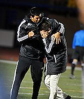 El Toro head coach, Shawn Watts, right, is overcome with emotion after his team won their CIF semifinal game in double overtime, beating Edison 2-1.