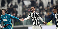 Calcio, Serie A: Juventus - AS Roma, Torino, Allianz Stadium, 23 dicembre, 2017. <br /> Juventus' goalkeeper Wojciech Szczesny (l), Medhi Benatia (c) and Alex Sandro (r) celebrate after winning 1-0 the Italian Serie A football match between Juventus and Roma at Torino's Allianz stadium, December 23, 2017.<br /> UPDATE IMAGES PRESS/Isabella Bonotto