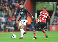 Burnley's Matthew Lowton under pressure from Southampton's Nathan Redmond<br /> <br /> Photographer Kevin Barnes/CameraSport<br /> <br /> The Premier League - Southampton v Burnley - Sunday August 12th 2018 - St Mary's Stadium - Southampton<br /> <br /> World Copyright &copy; 2018 CameraSport. All rights reserved. 43 Linden Ave. Countesthorpe. Leicester. England. LE8 5PG - Tel: +44 (0) 116 277 4147 - admin@camerasport.com - www.camerasport.com