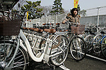 "March 16, 2010 - Tokyo, Japan - A woman exits the new Solar Parking Lots in Sentaya, Tokyo, Japan, with an electric hybrid bicycle ""eneloop"" on March 16, 2010. Completed by Sanyo Electric, the ""Solar Parking Lot"" incorporates solar panels and lithium-ion battery systems, and provision of 100 electric hybrid bicycles. (Photo Laurent Benchana/Nippon News)"