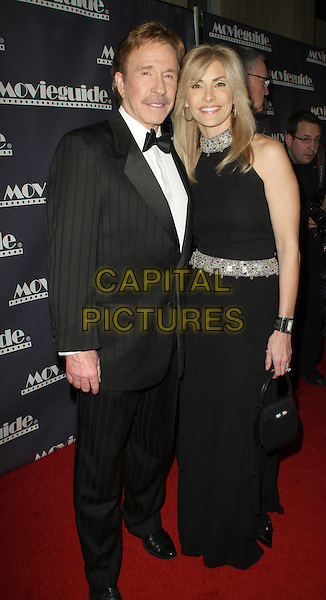 CHUCK NORRIS & GENA O'KELLEY.17th Annual Movieguide Faith and Values Awards Gala held at The Beverly Hilton Hotel, Beverly Hills, California, USA..February 11th, 2009.full length black tuxedo dress married husband wife.CAP/ADM/KB.©Kevan Brooks/AdMedia/Capital Pictures.