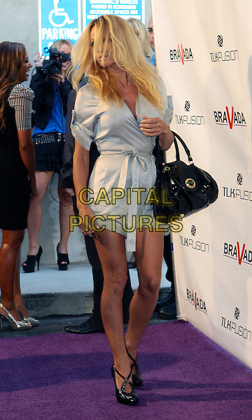 PAMELA ANDERSON .Bravada Women's Athletica Grand Opening Celebration held at Bravada store, Beverly Hills, California, USA, .10th June 2010..Full length black bag grey gray dress belt belted playsuit shoes wrap silver .CAP/ADM/TC.©T. Conrad/AdMedia/Capital Pictures.