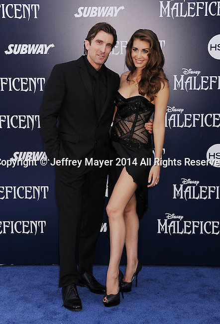 HOLLYWOOD, CA- MAY 28: Actor Sharlto Copley (L) and actress/model Tanit Phoenix arrive at the World Premiere Of Disney's 'Maleficent' at the El Capitan Theatre on May 28, 2014 in Hollywood, California.