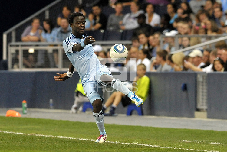 Kei Kamara (23) Sporting KC midfielder keeps the ball in play... Sporting Kansas City defeated Columbus Crew 2-1 at LIVESTRONG Sporting Park, Kansas City, Kansas.