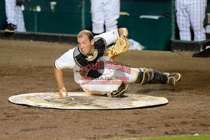 Bradenton Marauders catcher Jacob Stallings #5 retrieves a passed ball  during a game against the St. Lucie Mets on April 12, 2013 at McKechnie Field in Bradenton, Florida.  St. Lucie defeated Bradenton 6-5 in 12 innings.  (Mike Janes/Four Seam Images)