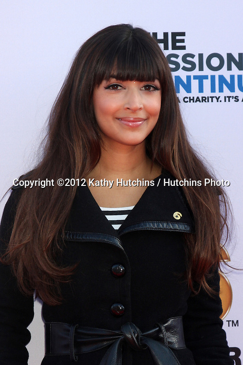 """LOS ANGELES - NOV 9:  Hannah Simone at the Veterans Day Service Event to feed LA Children sponsored by """"The Mission Continues"""" and """"Got Your 6"""" organizations. at Globe Theater at Universal Studios on November 9, 2012 in Los Angeles, CA"""