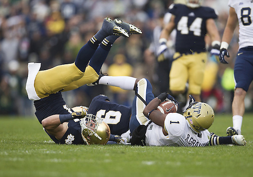 November 03, 2012:  Pittsburgh running back Ray Graham (1) is tackled by Notre Dame defenders during NCAA Football game action between the Notre Dame Fighting Irish and the Pittsburgh Panthers at Notre Dame Stadium in South Bend, Indiana.  Notre Dame defeated Pittsburgh 29-26 in three overtimes.