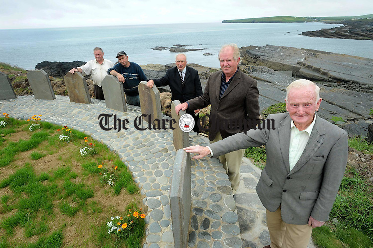 Sean Keating, Kilballyowen Development committee, Paddy Murray, munument designer, Ptrick Collins and Sean Mc Inerney, who worked on the project and landowner Thomas Mc Guire at the monument to the Yellow Men in Cross. Photograph by John Kelly..