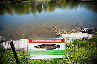 Fishermen in the Harlem Meer in Central Park in New York on Thursday, May 2, 2013 are advised to retain any Snakehead fish that they caught and to not return them to the Meer. The voracious invasive species has been spotted in the park and its presence can be devastating to the local fauna living in the man-made lake. The possession of the fish or its eggs as well as the sale and transport is a federal crime.  (© Richard B. Levine)