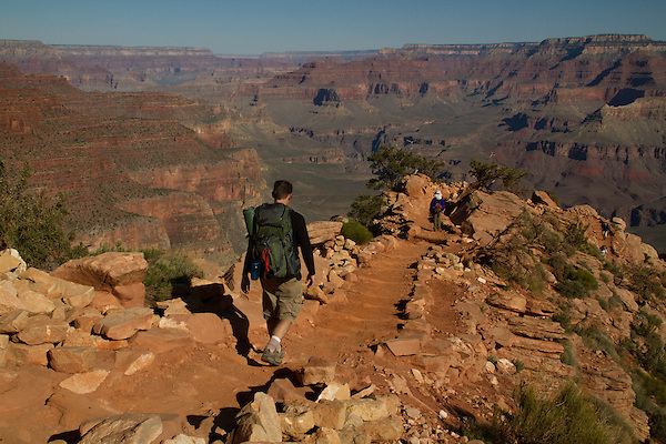Hiker on the South Kaibab Trail descending Cedar Ridge, South Rim in Grand Canyon National Park, northern Arizona. . John offers private photo tours in Grand Canyon National Park and throughout Arizona, Utah and Colorado. Year-round.