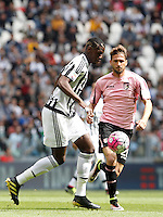 Calcio, Serie A: Juventus vs Palermo. Torino, Juventus Stadium, 17 aprile 2016.<br /> Juventus&rsquo; Paul Pogba, left, is challenged by Palermo&rsquo;s Franco Vazquez during the Italian Serie A football match between Juventus and Palermo at Turin's Juventus Stadium, 17 April 2016.<br /> UPDATE IMAGES PRESS/Isabella Bonotto