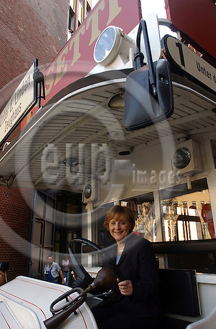 BERLIN - GERMANY 14. 11. 2006 -- In an archive photo from German election campaign in 2005 Angela Merkel sits behind the wheel of an old bus. German Chancellor Angela Merkel said in an interview newly she's a bad driver who paid her instructor to speed up the process of getting a licence -- PHOTO: GORM K. GAARE / EUP- IMAGES ...