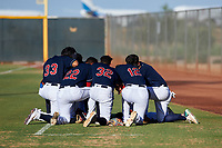 AZL Indians Red teammates pray before an Arizona League game against the AZL Padres 1 on June 23, 2019 at the Cleveland Indians Training Complex in Goodyear, Arizona. AZL Indians Red defeated the AZL Padres 1 3-2. (Zachary Lucy/Four Seam Images)