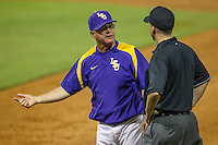 LSU Tigers Head Coach Paul Mainieri (1) argues with the first base umpire during a Southeastern Conference baseball game against the Texas A&M Aggies on April 24, 2015 at Alex Box Stadium in Baton Rouge, Louisiana. LSU defeated Texas A&M 9-6. (Andrew Woolley/Four Seam Images)