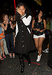 Aug 25th 2012 <br /> <br /> Rihanna going to Playhouse night club in Hollywood flicking off the camera wearing red lipstick a black &amp; white trench coat letterman's jacket gold watch <br /> <br /> <br /> AbilityFilms@yahoo.com<br /> 805 427 3519<br /> www.AbilityFilms.com